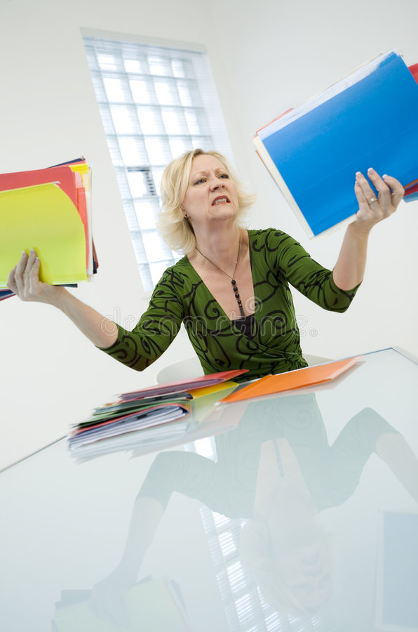 Upset woman holding folders stock photo