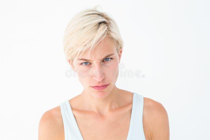 Upset woman looking at camera stock photo