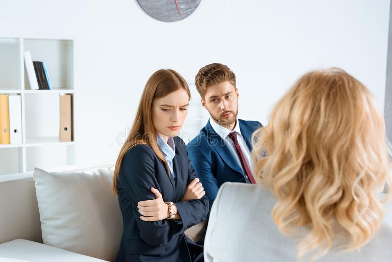 upset young couple visiting royalty free stock photo