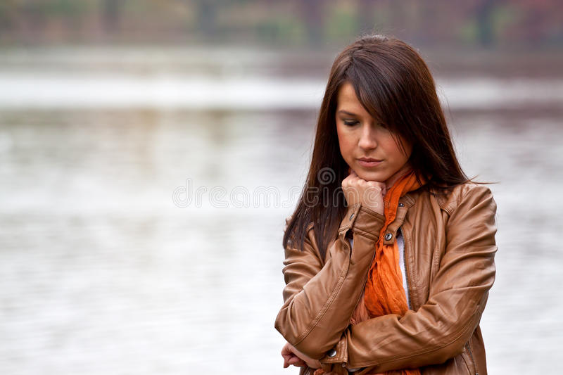 Upset young woman with eyes closed stock image
