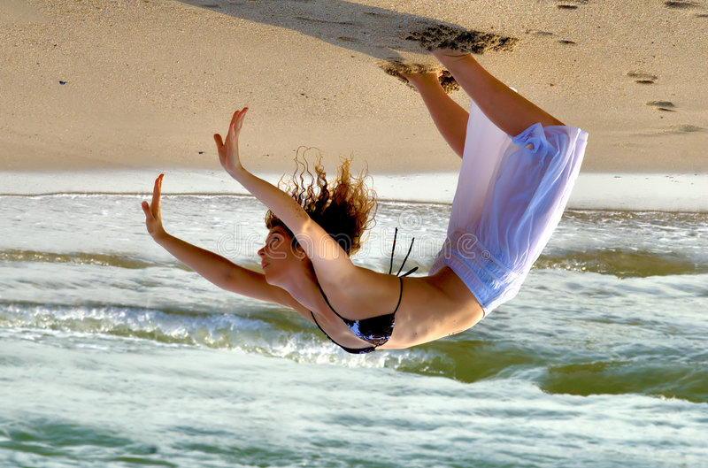 Download Upside down stock photo. Image of athletic, beach, water - 2887524
