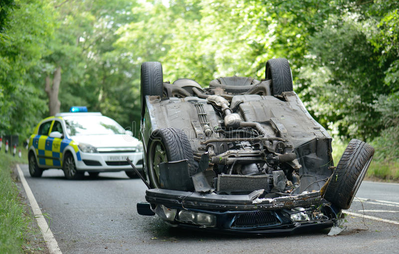 Upside down car. Car accident crash flipped upside down, road closed by police stock image