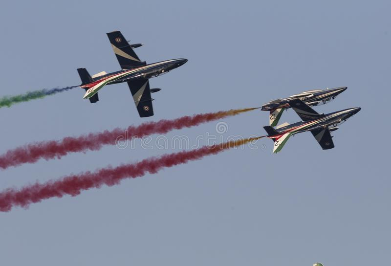 Planes jet upside down flight at the italian tricolor arrows air show vector illustration
