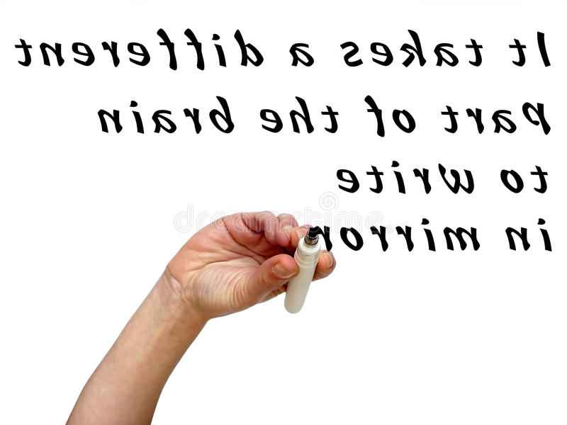 Upside down hand mirror writing words in with black marker. On transparent whiteboard royalty free stock photo