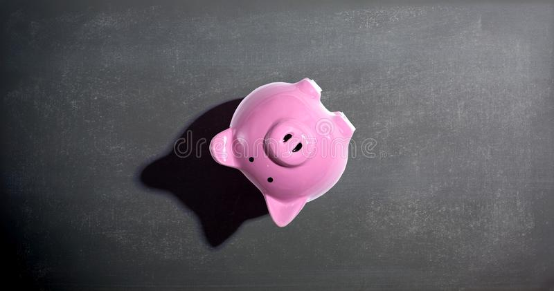 Upside down piggy bank. Overhead view flat lay stock image