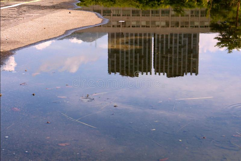 Upside down-reflection of city buildings stock images
