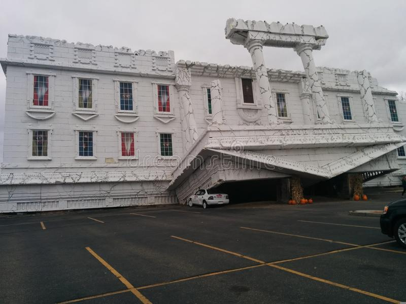 Upside-down White House in parking lot stock photography