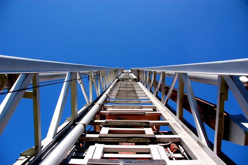 Fire ladder. Upside view on a silver ladder of a fire brigade stock photography