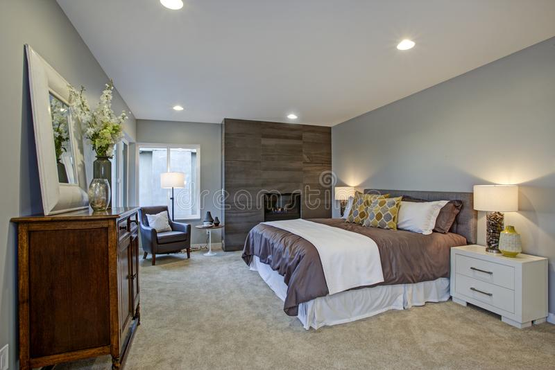 Upstairs stunning master bedroom with fireplace and private deck stock image