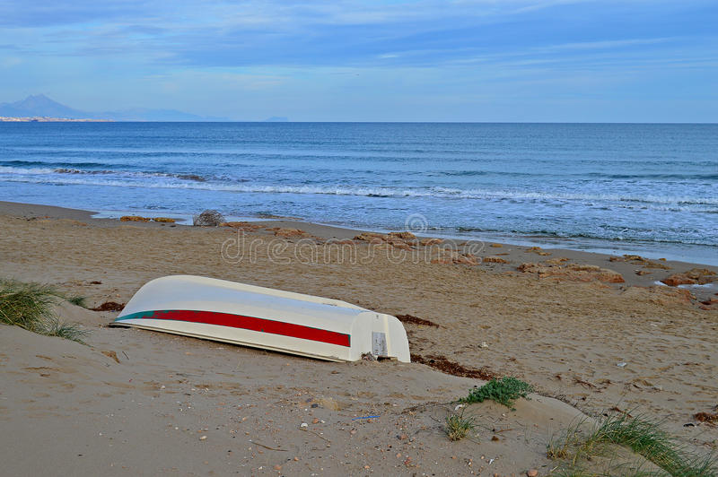 Upturned Boat On The Beach stock photos
