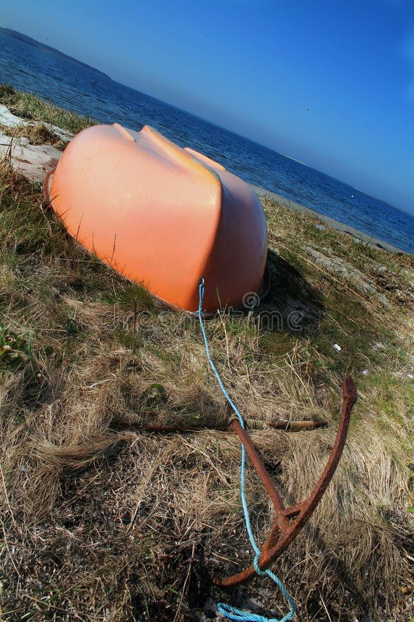Upturned Boat By Sea Stock Photos