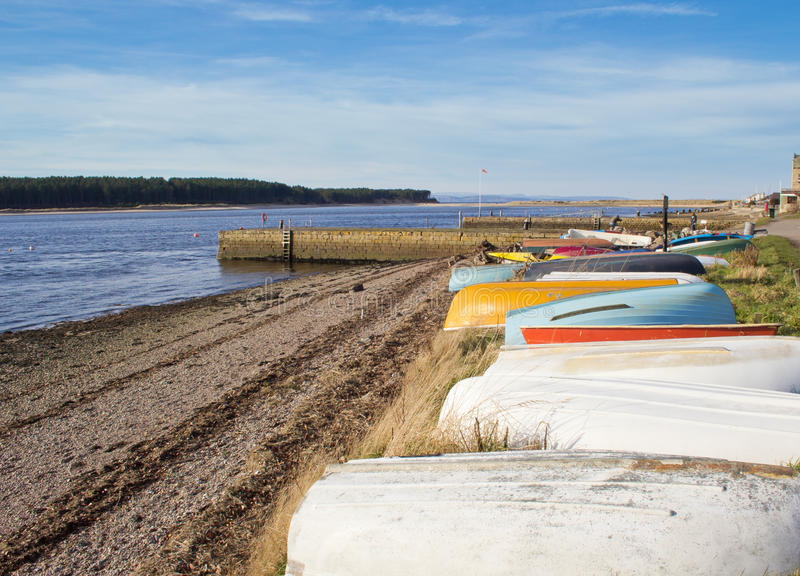 Upturned boats on beach stock image