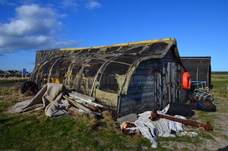 upturned boats on the Holy island stock image