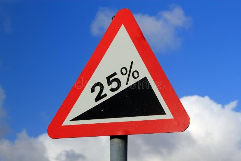 Upward climb. Street sign showing a 25% gradient symbolizing a sharp increase, upward climb and struggle stock photography