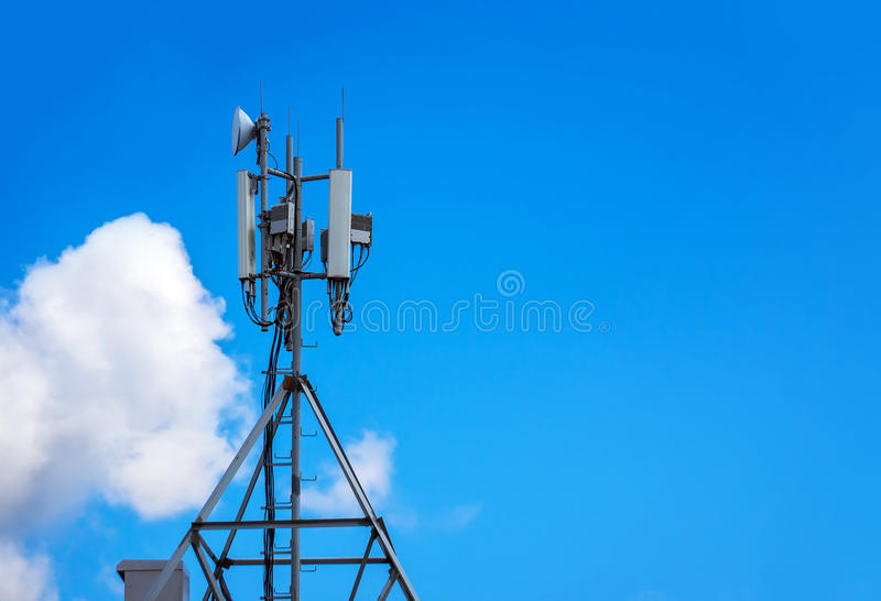Upward of Communication Radio antenna Tower. Microwave antenna tower on blue sky background. Antenna for cellular communication stock photo