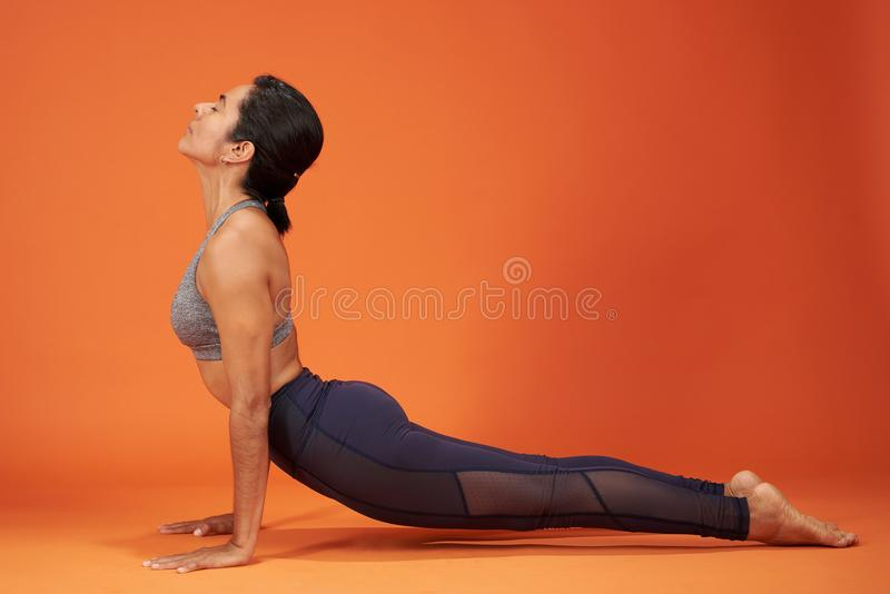 Upward Facing Dog yoga pose stock photo