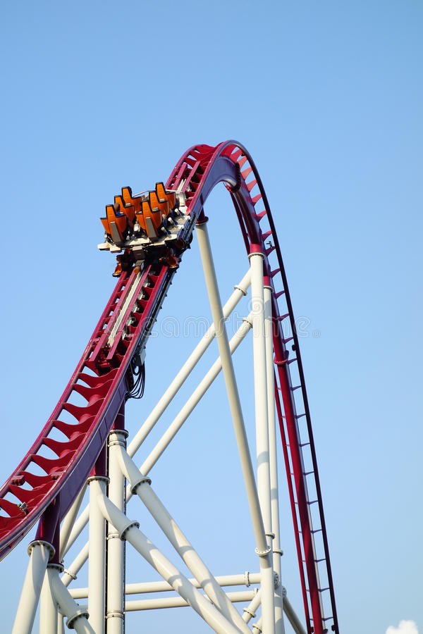 Vacant roller coaster car going upward at full speed royalty free stock photos
