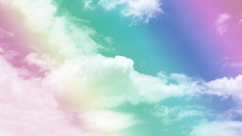 Upward skyscape view to cloudscape, shape of white fluffy clouds look like the eagle flying on vivid blue sky in a suny day stock photo