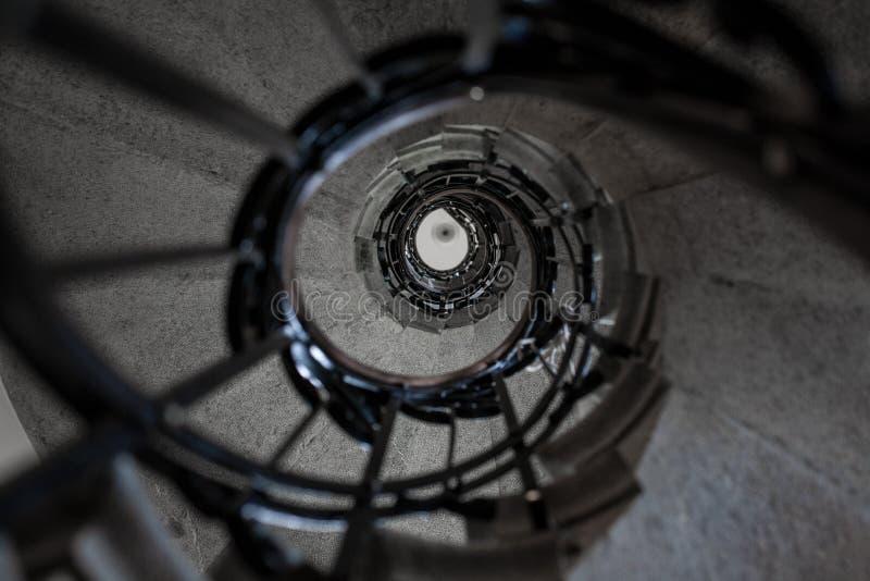 Upward stone spiral stairway. Vintage upward stone spiral stairway stock photo