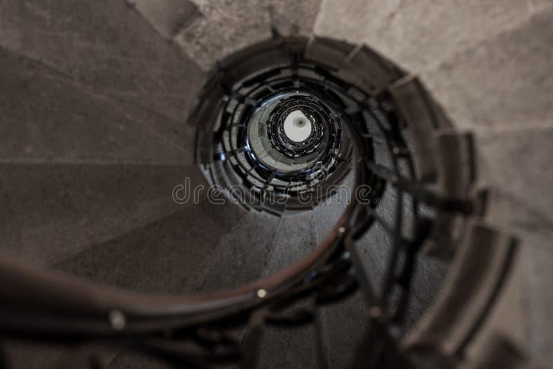 Upward stone spiral stairway. Vintage upward stone spiral stairway stock photography