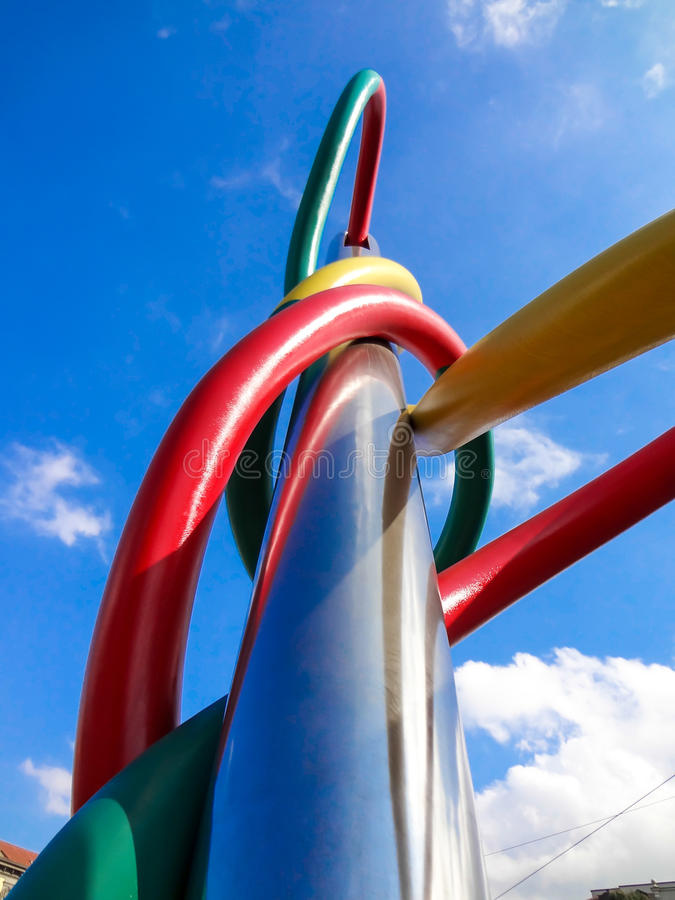 Upward view of the fashion monument in the center of Milan, Italy. Representation of a needle and colored threads stock image