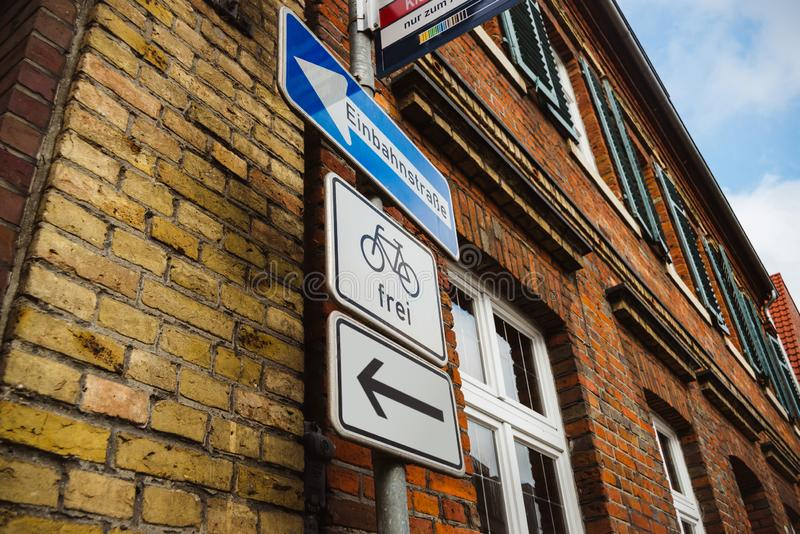 Upward view on main street Hauptstrasse street sign and bicycle road in german. Upward view on main street street sign and bicycle road in german stock image
