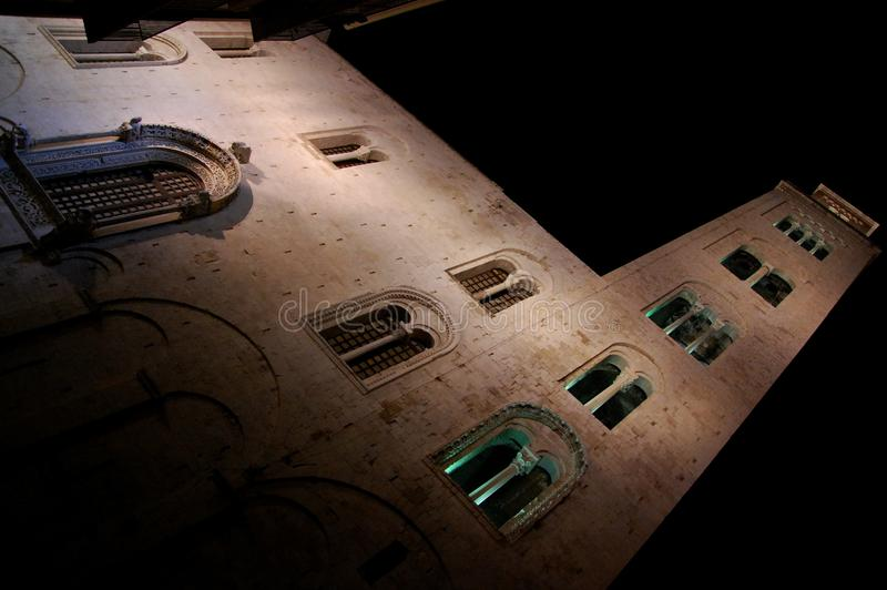 Upward view of a medieval cathedral bell tower at night. Bari, Apulia, Southern Italy royalty free stock photography