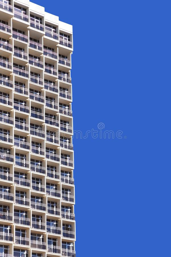 Balconies of modern hotel. Upward View on Modern Building. Balconies of modern hotel. Bright blue sky background stock photos