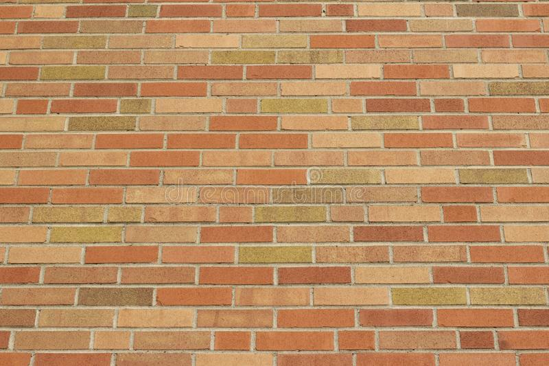 Upward view of a modern orange tone clay brick wall texture with a grunge look stock photo