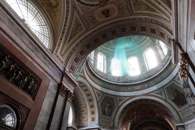 Upward view on round dome on top of Primatial Basilica of the Blessed Virgin Mary Assumed Into Heaven and St Adalbert in Esztergom. Green protective network stock photography