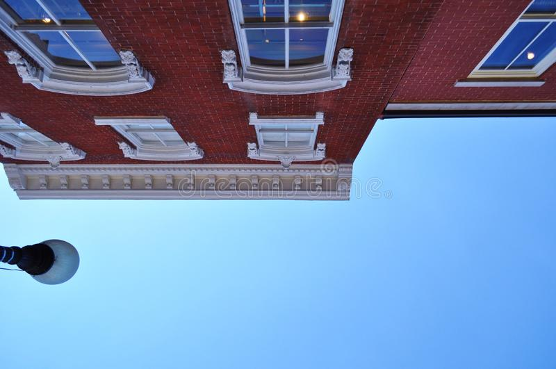 An upward view and two different colors. An upward view, seeing two beautiful different colors in one frame. A blue color from a blue sky, a red color from a stock photos