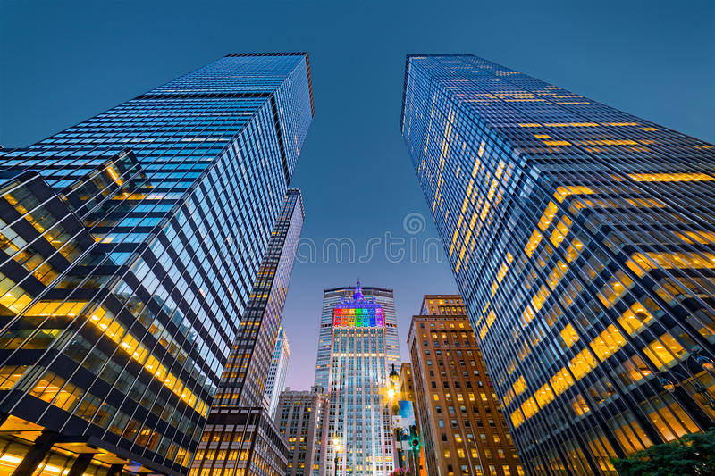 Upwards view of New York skyscrapers at dusk royalty free stock image