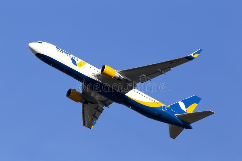 UR-AZK Azur Air Ukraine Boeing 767-300 aircraft on the blue sky background stock image