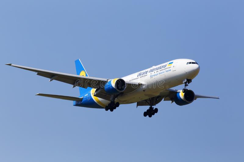 UR-GOA Ukraine International Airlines Boeing 777-200 on the blue sky background royalty free stock photography