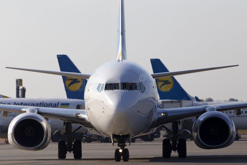 UR-PSZ Ukraine International Airlines Boeing 737-800 aircraft running to the Borispol International Airport parking. Borispol, Ukraine - September 10, 2019: UR royalty free stock images