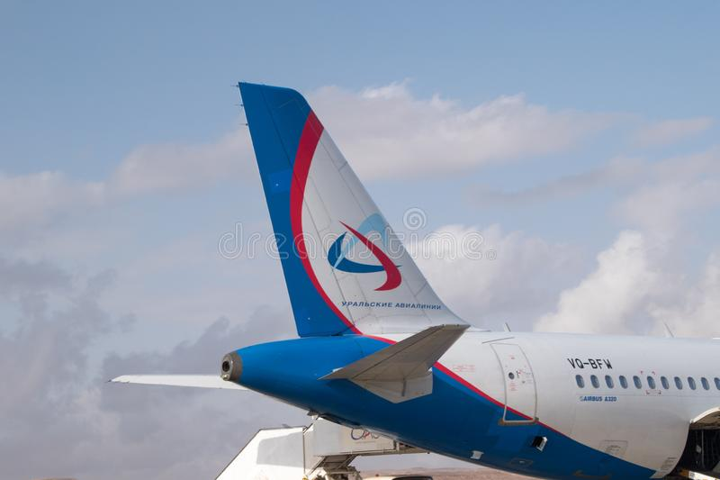 Ural Airlines logoand sign on the tail of aircraft royalty free stock photo