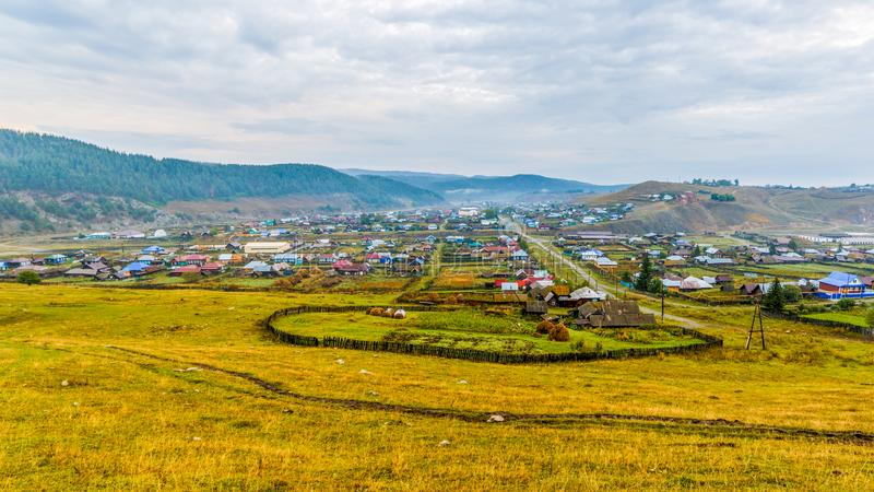 Ural village Kaga. Panorama of the South Ural village. Bashkortostan. Cloudy summer day royalty free stock photos
