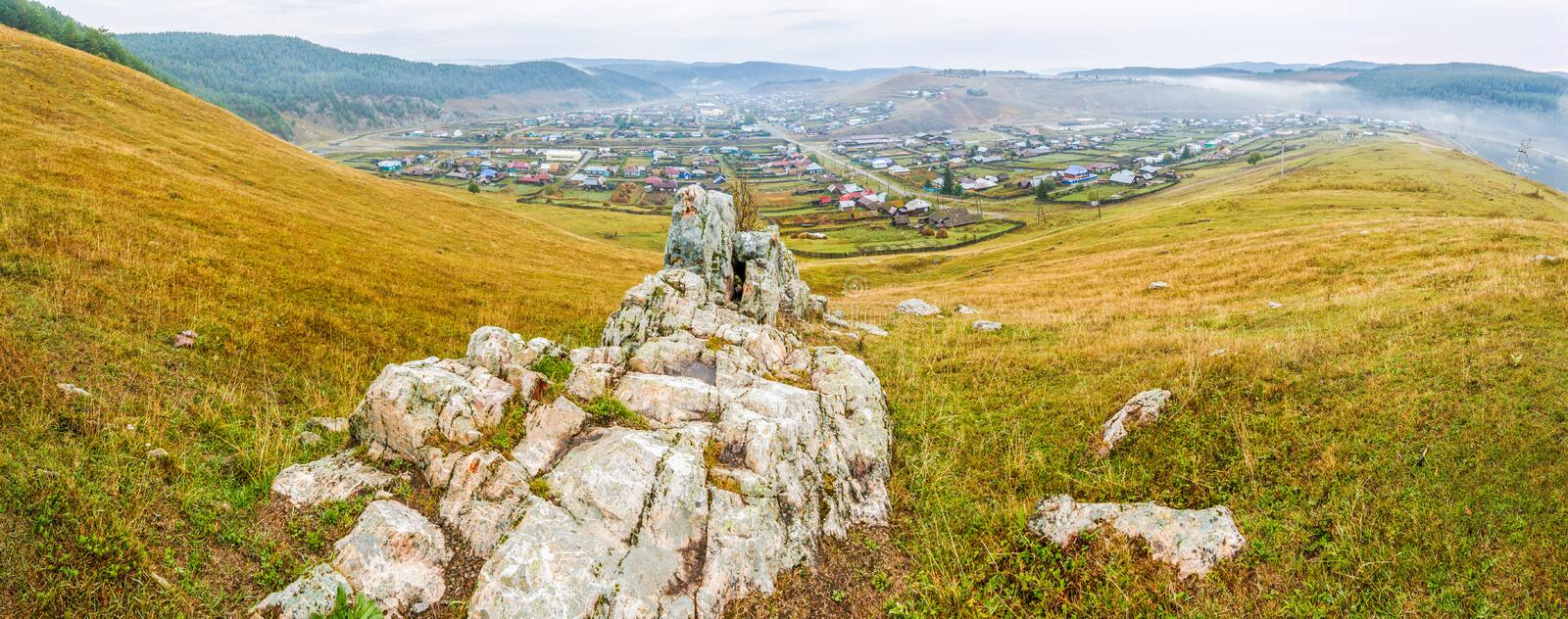 The Ural village in the mountains. Kaga. Bashkortostan. Picturesque Ural sights. The Ural village in the mountains. Kaga. Bashkortostan stock image