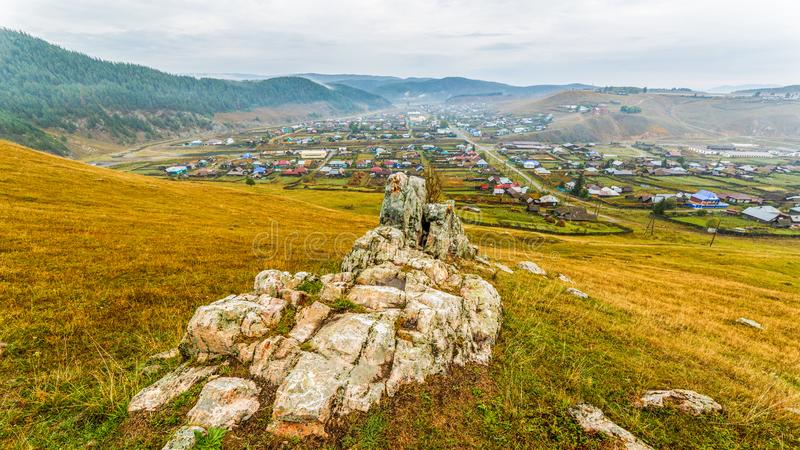 The Ural village in the mountains. Kaga. Picturesque Ural valley. The village in the mountains. Kaga. Bashkortostan stock images