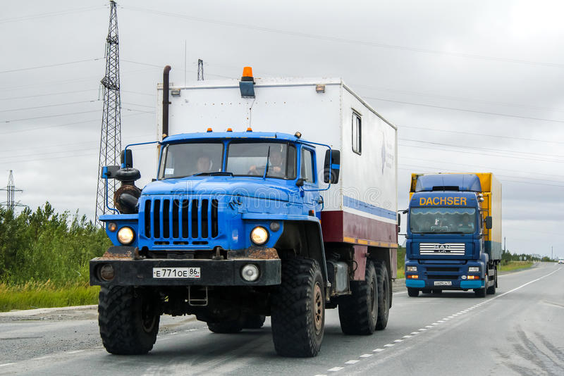 Ural 4320. YAMAL, RUSSIA - AUGUST 5, 2012: Geophysics researches truck Ural 4320 at the interurban road stock photography
