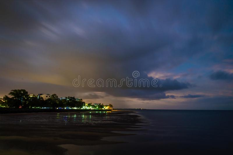 Urangan at night with lights on and red clouds royalty free stock image