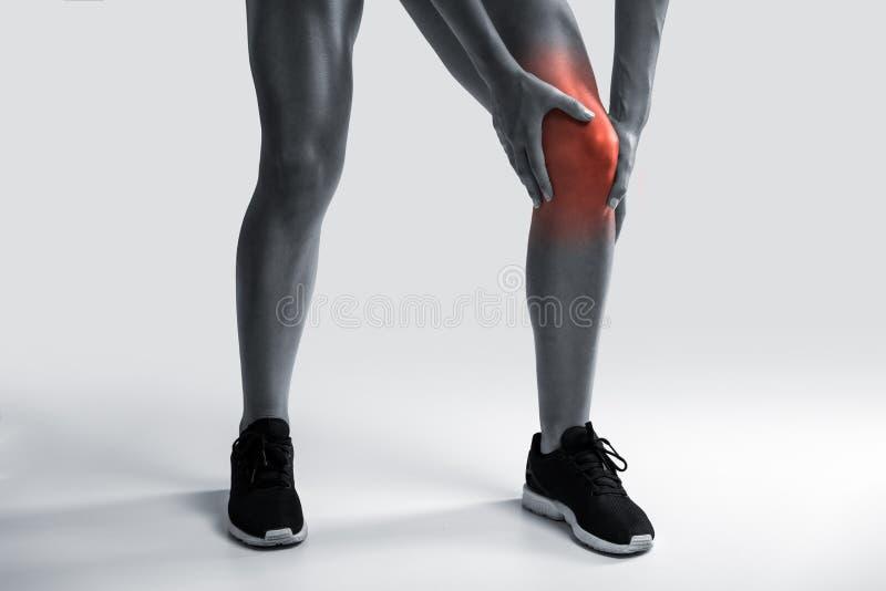 urazu kolanowego samiec bólu biegacza działający sporty fotografia royalty free