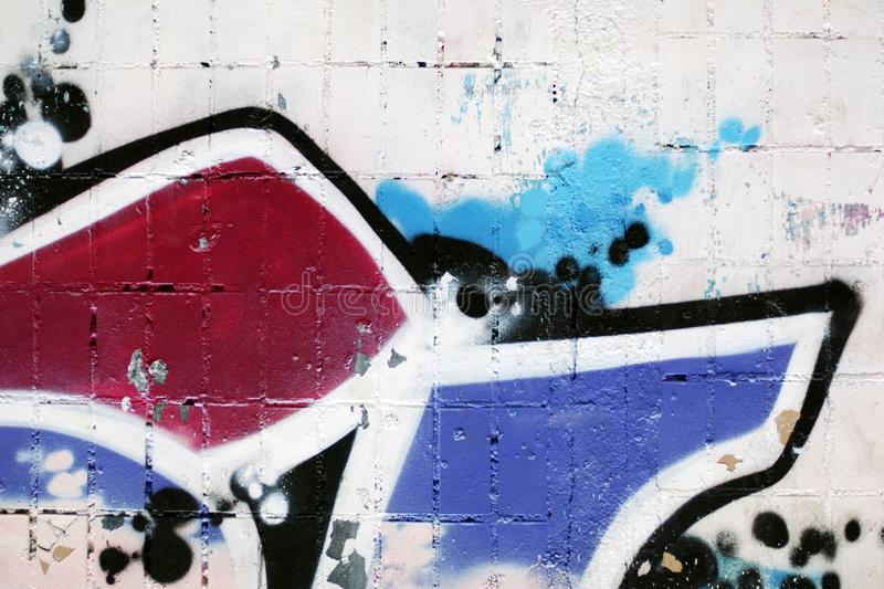 Urban abstract background, shabby wall with fragments of colorful paint stock image