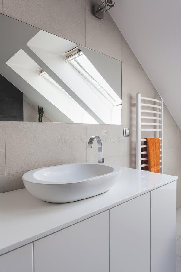 Urban apartment - round sink. Urban apartment - white round ceramic sink in bathroom stock images