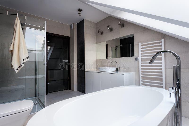 Urban apartment - stylish bathroom. Urban apartment - bath, shower and wc in bathroom stock image