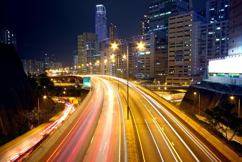 Urban area dusk. Busy traffic royalty free stock image