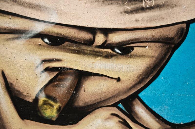 Urban art -cigar smoker royalty free stock image