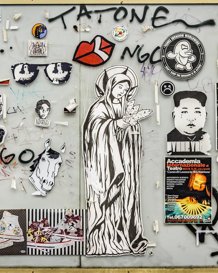 Urban Art Collage, Rome, Italy. ROME, ITALY, JANUARY - 2018 - Collage of stickers, stencils, graffities and posters at wall in rome, Italy royalty free stock photos