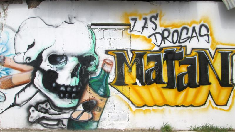 Urban Art in eastern Venezuela. Graffiti located in the sector Caigüire Cumana, Sucre State, Venezuela. the words can be read: drugs kill stock photo