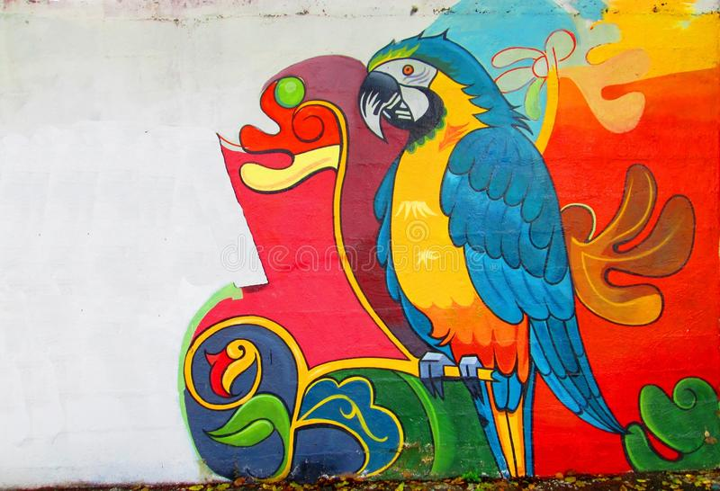 Urban art. Macaw. Painting on a wall of Puerto Ordaz , Venezuela , South America. It shows a colorful Macaw , also known as macaws flag. Graffiti street stock photography